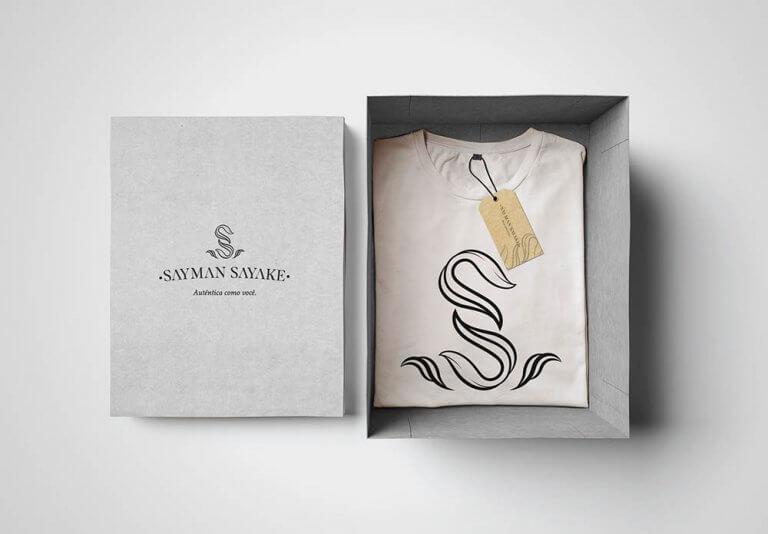 Sayman Sayake - logo para loja de roupas feminina por Cratera Design